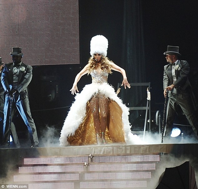 She means business: Jennifer, seen onstage in Montreal, has a fabulous white feather train and matching fur hat that's reminiscent of Buckingham Palace's guards