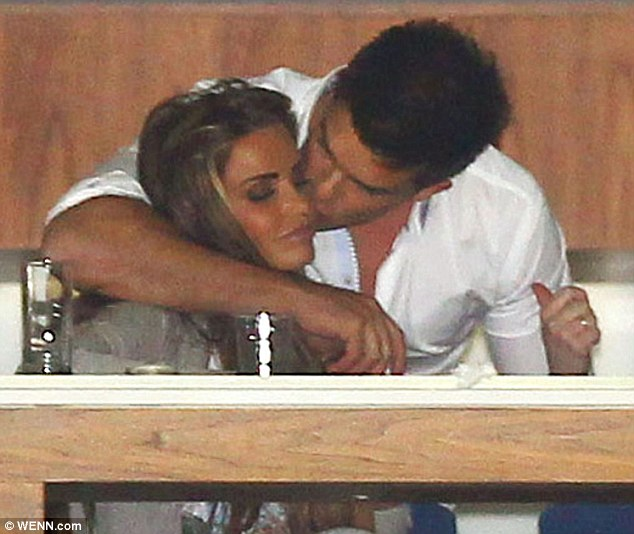 Tender: Leandro Penna plants a kiss on Katie Price's cheek as they watch the HPA Gaucho International Polo at London's O2 Arena last night