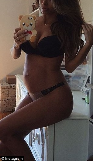 Proud of her bump: Sarah struck various photos for these selfies of herself in her underwear