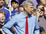 Arsenals French manager Arsene Wenger (L) reacts after the sending off of Arsenals Brazilian defender Gabriel (R) during the English Premier League football match between Chelsea and Arsenal at Stamford Bridge in London on September 19, 2015. AFP PHOTO / IAN KINGTON  RESTRICTED TO EDITORIAL USE. No use with unauthorized audio, video, data, fixture lists, club/league logos or 'live' services. Online in-match use limited to 75 images, no video emulation. No use in betting, games or single club/league/player publications.IAN KINGTON/AFP/Getty Images