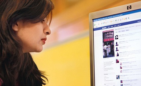 A woman chatting on Facebook, a site that could be monitored in internet cafes
