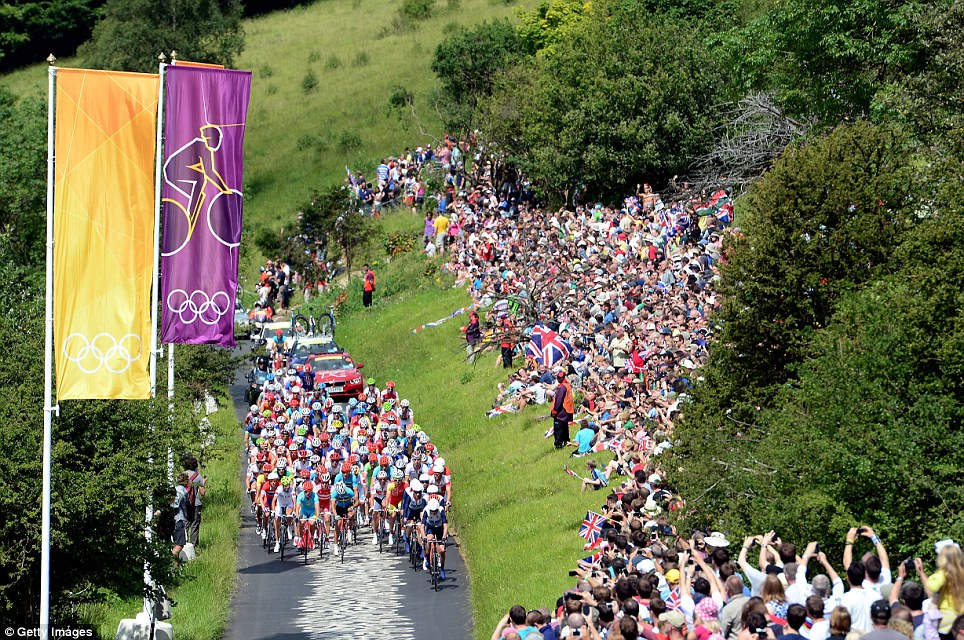 Tightly bunched: The peloton (main group of riders) complete one of the nine circuits of Box Hill in Surrey as the dramatic race heated up