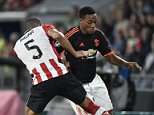 Manchester's Anthony Martial  (R) vies with PSV Eindhovens Jeffrey Bruma (L) during the UEFA Champions League Group B football match between PSV Eindhoven and Manchester United at the Philips stadium in Eindhoven, Belgium on September 15, 2015. AFP PHOTO / JOHN THYSJOHN THYS/AFP/Getty Images
