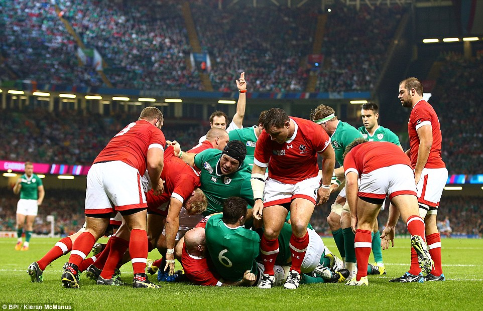 Sean O'Brien scored the first try of Ireland's Rugby World Cup opener against Canada after touching down beneath a pile of bodies