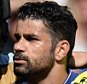 Diego Costa of Chelsea grapples with Gabriel Paulista of Arsenal and Laurent Koscielny of Arsenal eventually leading to a sending off for Gabriel Paulista during the Barclays Premier League match between Chelsea and Arsenal played at Stamford Bridge, London on September 19th 2015