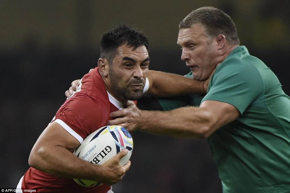 Canada's scrum-half Gordon McRorie is chalenged as he attempts to start an attack for his side against Ireland
