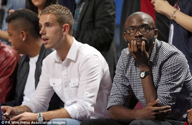 Keep smiling people: Muamba, right, attended an Olympic  basketball warm-up match before the games with Liverpool's Jordan Henderson, left, last month