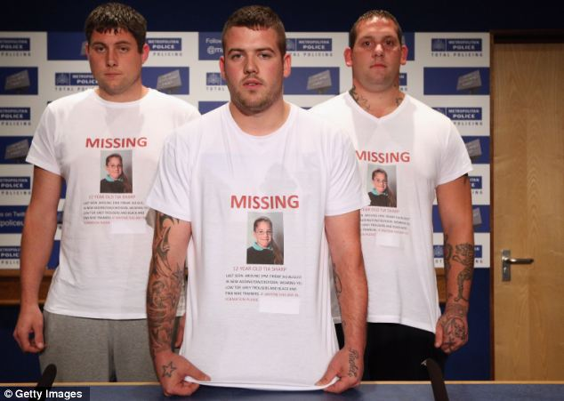 Appeal: Tia's uncle David Sharp (centre) and his friends Mark Havers (left) and Steven Subine (right) wore t-shirts bearing the girl's picture as he urged her to return home