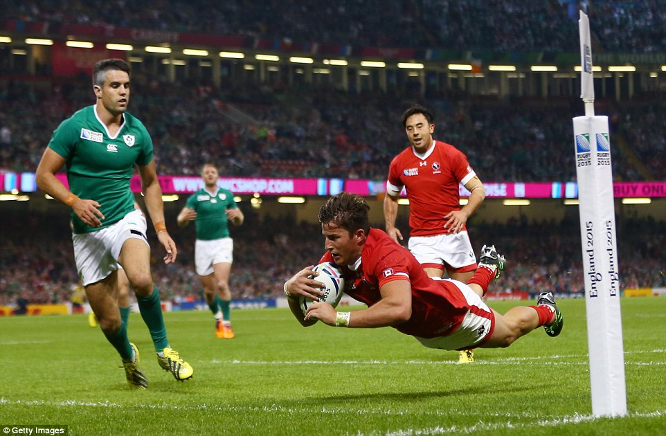 DTH Van Der Merwe of Canada dives over to score a try which was later disallowed by the referee