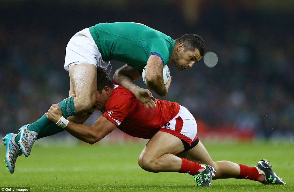 Rob Kearney runs into a strong challenge made byVan Der Merwe of Canada as Ireland ease to victory on Saturday afternoon