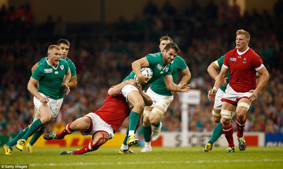 Jared Payne of Ireland attempts to break through a tackle as Ireland begin their World Cup campaign in style