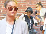 Gigi Hadid seen walking in SoHo, she gets stopped by an elderly lady in the middle of her walk\n\nPictured: Gigi Hadid\nRef: SPL1130563  180915  \nPicture by: Gachie / Splash News\n\nSplash News and Pictures\nLos Angeles: 310-821-2666\nNew York: 212-619-2666\nLondon: 870-934-2666\nphotodesk@splashnews.com\n