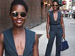 **NO NY PAPERS** New York, NY - Mexican-Kenyan beauty Lupita Nyong'o dazzles in a cleavage-baring pinstriped jumpsuit as she exits The Late Show with Stephen Colbert. Lupita was recently featured on the front cover of Vogue, which marks her second cover with the prestigious fashion magazine. \n  \nAKM-GSI       September 18, 2015\n **NO NY PAPERS**\nTo License These Photos, Please Contact :\nSteve Ginsburg\n(310) 505-8447\n(323) 423-9397\nsteve@akmgsi.com\nsales@akmgsi.com\nor\nMaria Buda\n(917) 242-1505\nmbuda@akmgsi.com\nginsburgspalyinc@gmail.com