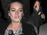 17 Sep 2015  - LONDON  - UK *** EXCLUSIVE ALL ROUND PICTURES *** LINDSAY LOHAN SPOTTED WALKING DOWN BRICK LANE IN EAST LONDON. THE FORMER CHILD STAR WAS ACTING STRANGE WHEN SHE SPOTTED PHOTOGRAPHERS AND QUICKLY GOT RID OF HER DRINK AND CIGARETTE! BYLINE MUST READ : XPOSUREPHOTOS.COM ***UK CLIENTS - PICTURES CONTAINING CHILDREN PLEASE PIXELATE FACE PRIOR TO PUBLICATION *** **UK CLIENTS MUST CALL PRIOR TO TV OR ONLINE USAGE PLEASE TELEPHONE  442083442007