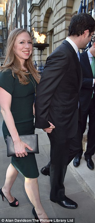 Chelsea holds hands with her husband as they make their way inside
