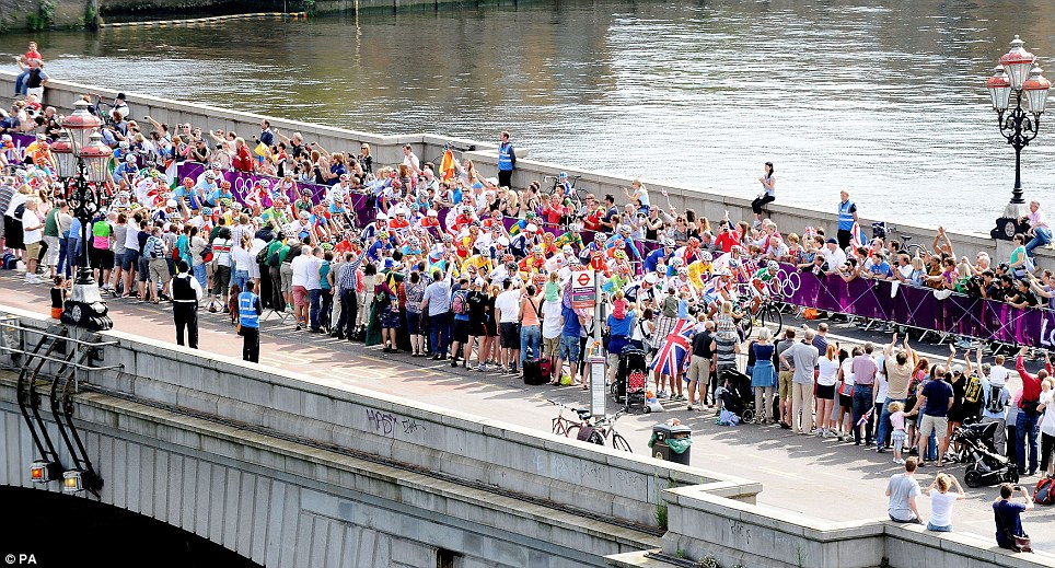 The riders cross Putney Bridge in south west London near the start of the six-hour race