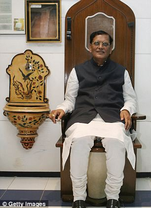 Founder: Dr Bindeshwar Pathak, sits on a toilet designed as a replica of the throne of French King Louis XIV at the Sulabh International Toilet Museum