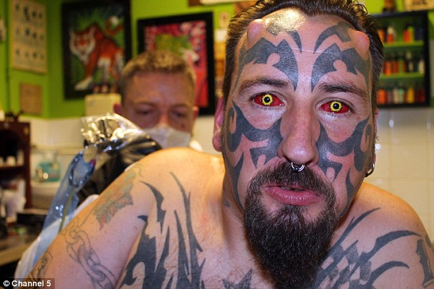 Terrifying: Delenfer, 43, has spent £10,000 on his bid to look exactly like Lucifer - complete with devilish horns