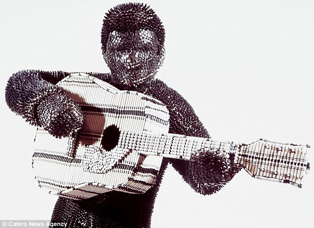Guitar hero: Herb Williams's sculptures consist of hundreds and thousands of Crayola crayons, fixed into shape using industrial adhesive