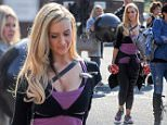 Coronation Street star Cath Tyldesley leaving a studio in Manchester in her gym wear after photo shoot. Cath walked out and was making nothing of the two 10kg weights with Manchester written on them as she carried one in each hand. Also used in the shoot a large gym ball which was brought  out with them. \\n   \\n***EXCLUSIVE ALL ROUND***\\n\\n***PLEASE NO BYLINE***