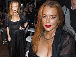 Lindsey Lohan at Gareth Pugh show at London Fashion Week LFW\n\nPictured: Lindsey Lohan\nRef: SPL1131232  190915  \nPicture by: Reimschuessel / Splash News\n\nSplash News and Pictures\nLos Angeles: 310-821-2666\nNew York: 212-619-2666\nLondon: 870-934-2666\nphotodesk@splashnews.com\n