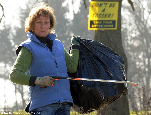 Rubbish row: Jo Riddell has been causing a stink in her village with her anti-litter signs, which she felt compelled to put up after having to collect piles of detritus outside her home