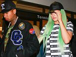 Los Angeles, CA - Kylie Jenner and her boyfriend Tyga hold hands as they make their way through LAX. The high profile couple is back from a visit to New York for Fashion Week. The 'Keeping Up With The Kardashians' star wore a black and white graphic tee with a pair of black leggings and Nike high tops. Kylie covered her green tinted hair beneath a black leather ball cap. AKM-GSI         September 16, 2015 To License These Photos, Please Contact : Steve Ginsburg (310) 505-8447 (323) 423-9397 steve@akmgsi.com sales@akmgsi.com or Maria Buda (917) 242-1505 mbuda@akmgsi.com ginsburgspalyinc@gmail.com