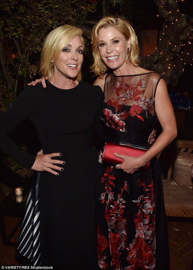 Fashionable friends: Julie Bowen looked stunning in a black and red sheer gown with her hair styled into loose blonde waves