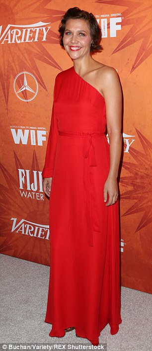Lady in red: Another nominee to attend the evening was Maggie Gyllenhaal, who oozed sophisticated glamour in a one-shouldered red gown which matched her crimson lipstick