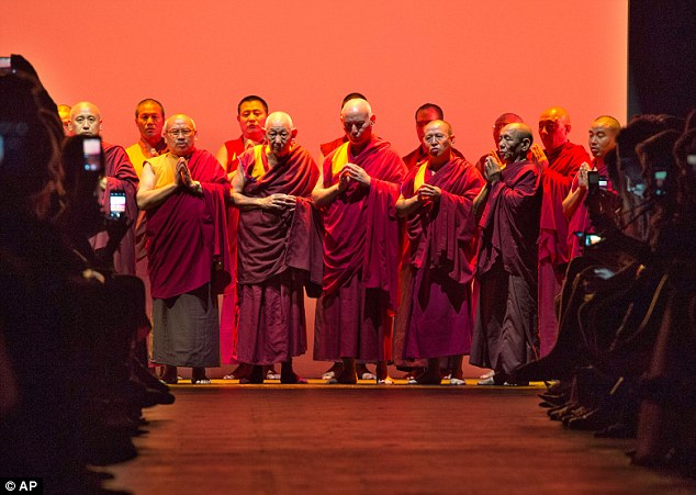 Tribute: Buddhist monks perform before the Prabal Gurung Spring 2016 collection is modeled during Fashion Week in New York