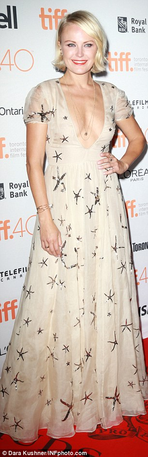 Life aquatic: Her co-star Malin Ackerman wore a cream gown with sequinned starfish