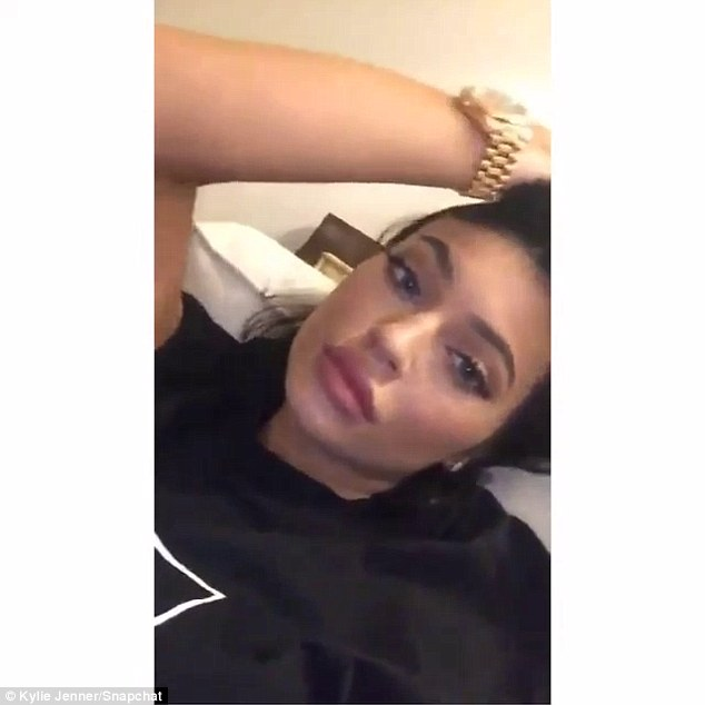 Face time: Kylie contined to show off her plump pout with selfie videos