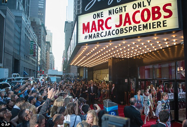 Showing now: Marc Jacobs' show was a cheeky, Americana-filled homage to ultra-glamorous, 1950s Hollywood, with lots of gowns and plenty of sparkle, held at NYC's Ziegfeld Theatre