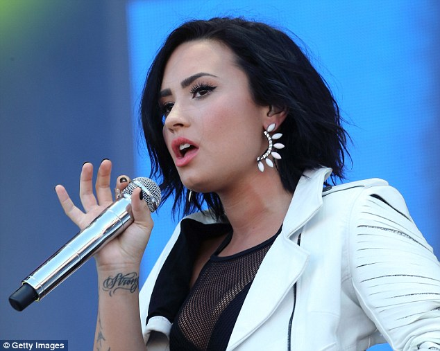 Wild look: With her loose hair and funky white jacket, Demi had an interesting and edgy look
