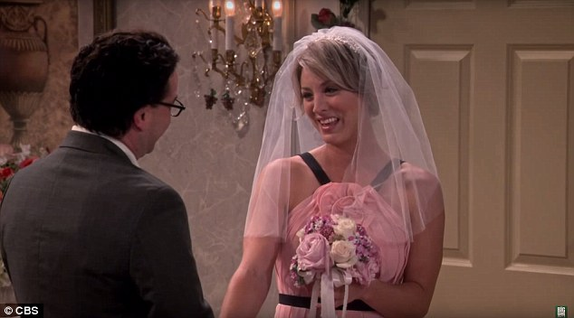 Still romantic:Of course Penny will also have the classic white veil and looks to be carrying a dress-matching bouquet of pink flowers