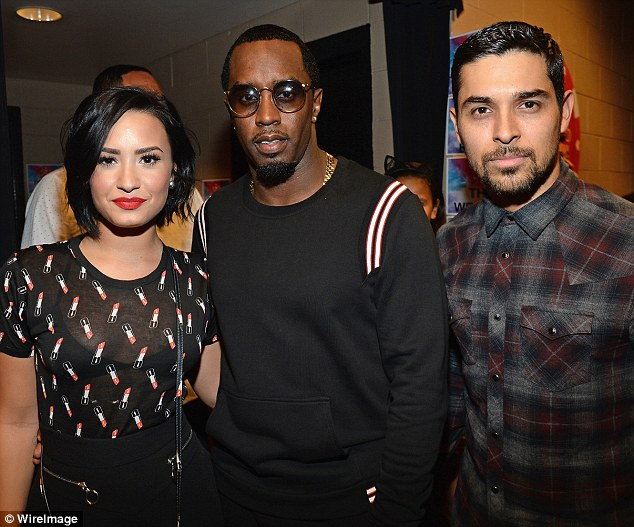 Day into night: Later on the songstress posed alongside PDiddy and boyfriend Wilmer Valderrama