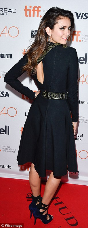 Peekaboo: Her frock featured a daring slashed neckline with an almost keyhole cutout