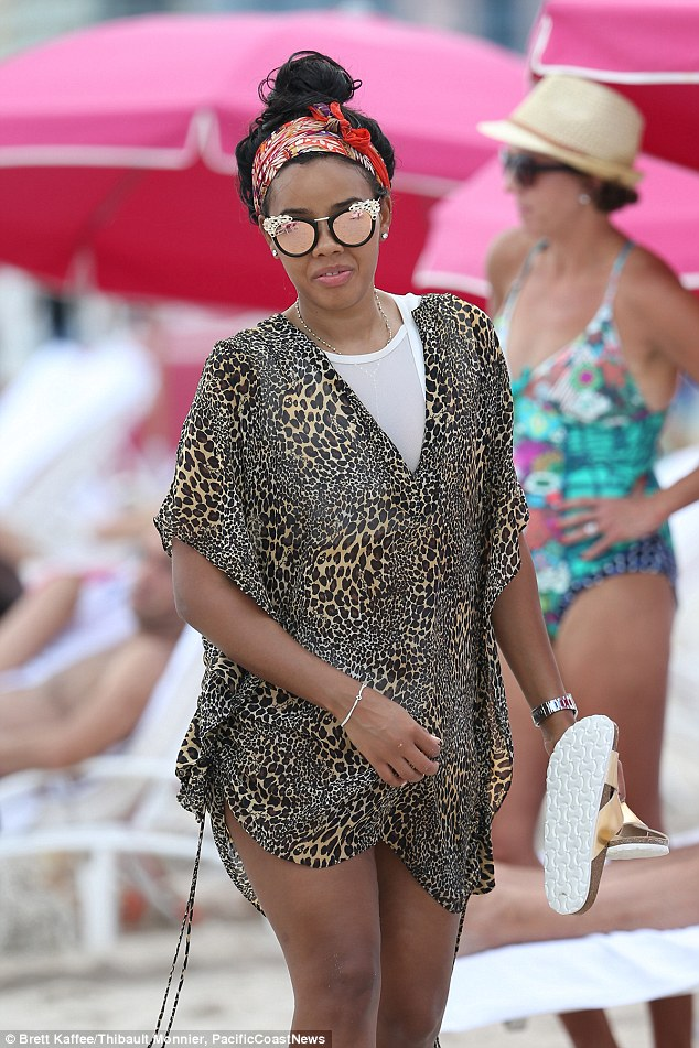 Miami heats up:After celebrating her 28th Birthday the night before, Angela looked flawless as she showed off her body in a white bikini, with her hair tied up in a red scarf