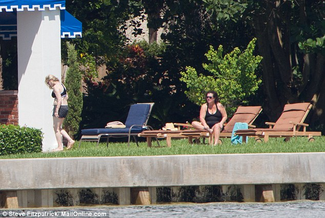 The couple basked in the sun as dozens of boaters also took advantage of the Saturday sunshine to go up and down Florida's Intracoastal Waterway