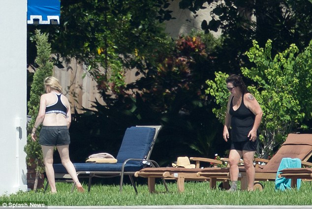 With 78 per cent humidity in West Palm Beach on Friday, it was the perfect day for Rosie and Tatum to relax by the pool