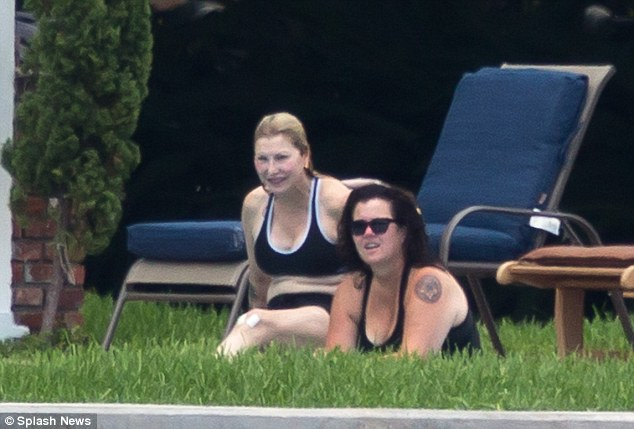 Rosie O'Donnell and Tatum O'Neal soak up some Florida sunshine as they lounge in beach chairs on Saturday
