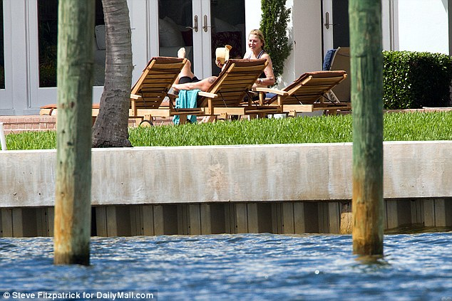 The couple chatted with one another from their lounge chairs as they soaked up the sun