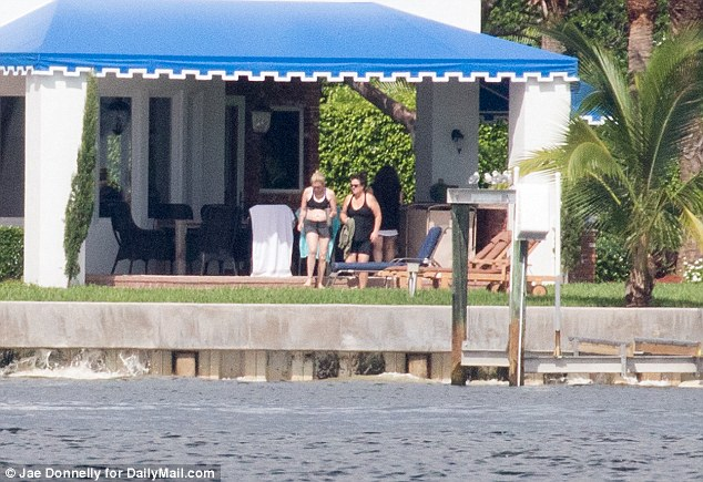The couple casually walked around the mansion's backyard as they enjoyed their day out by the pool