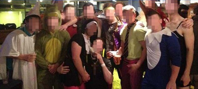 'Bad taste': The UEA rugby team has been disbanded after dressing up in obscene costumes on the night out. Here a number of players are pictured on the night out - including one (left) who is allegedly in a Klu Klux Klan outfit