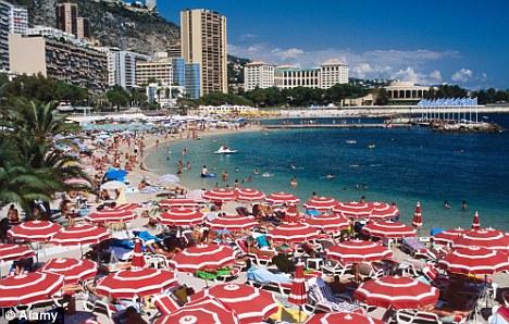 Mediterranean idyll: Monaco's Larvotto Beach on a summer's day