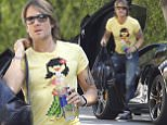 Picture Shows: Keith Urban  September 19, 2015\n \n Singer, Keith Urban, is spotted out and about in West Hollywood, California. New Idea magazine stated that he and his wife, Nicole Kidman are rumored to be expecting their third child.\n \n EXCLUSIVE ALL ROUNDER\n UK RIGHTS ONLY\n FameFlynet UK © 2015\n Tel : +44 (0)20 3551 5049\n Email : info@fameflynet.uk.com