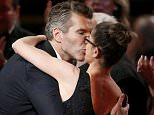 "David Benioff kisses his wife, actress Amanda Peet, as he takes the stage to accept the award for Outstanding Writing For A Drama Series for HBO's ""Game of Thrones"" at the 67th Primetime Emmy Awards in Los Angeles, California September 20, 2015.  REUTERS/Lucy Nicholson"