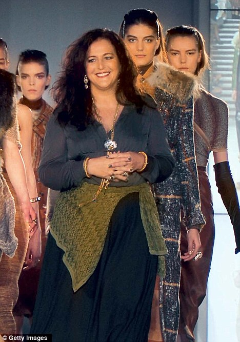 Italian brand Missoni's co-owner Angela Missoni walks the ramp with models during one of her fashion shows in Italy