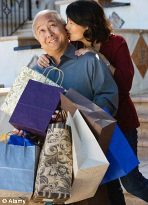 Chivalrous: Julie's husband always carries her bags for her (posed by models)
