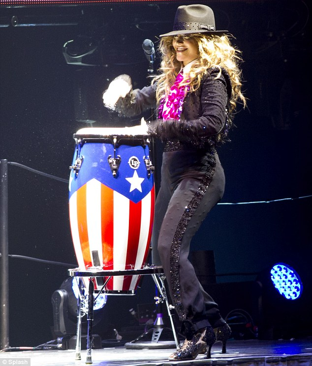 Drummer girl: Donning a fedora and a feminine version of a Spanish matador outfit, Jennifer played bongos bearing the flag of her Puerto Rican roots